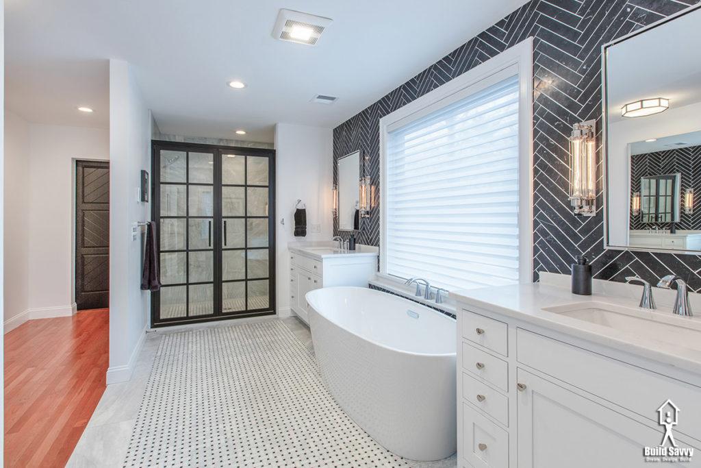 Walk in bathroom with black herringbone tile