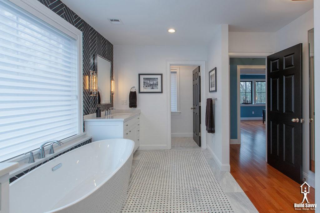 Exposed round tub with herringbone tile
