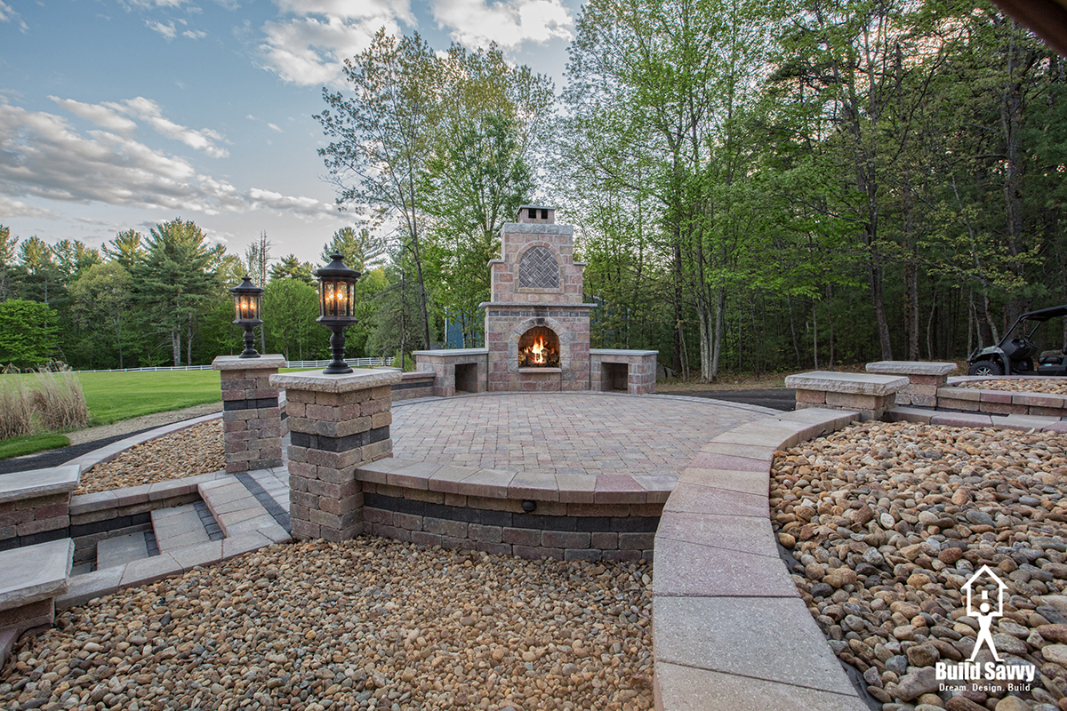 Patio with fireplace and lanterns