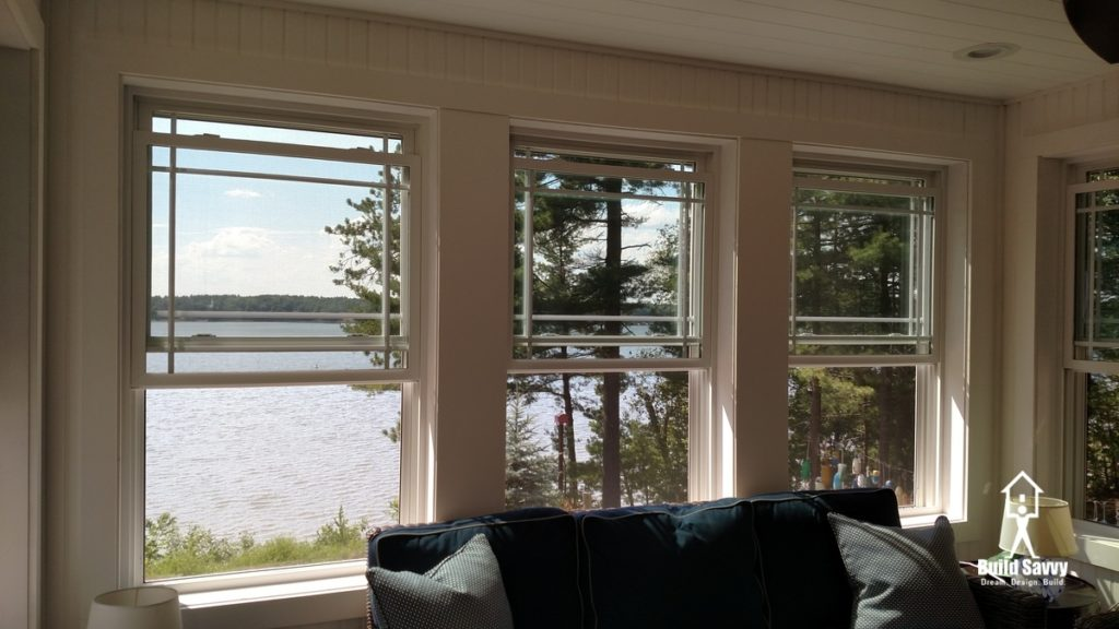 Three windows on the porch overlooking a lake